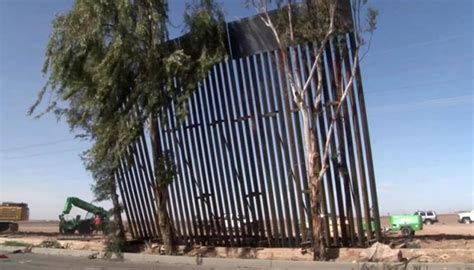'Strong breeze' blows down part of Trump's Mexico border